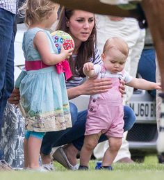 June 15, 2014 - Cirencester, England, United Kingdom - CATHERINE DUCHESS OF CAMBRIDGE and PRINCE GEORGE play on the sidelines as Princes William and Harry play in the Jerudong Polo Trophy competition at the Cirencester Polo Club. (Credit Image: © /i-Images/ZUMA24.com)